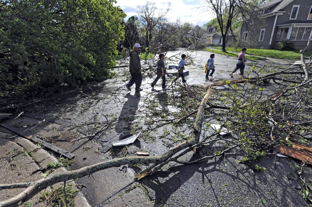 Residents walk through tornado damage