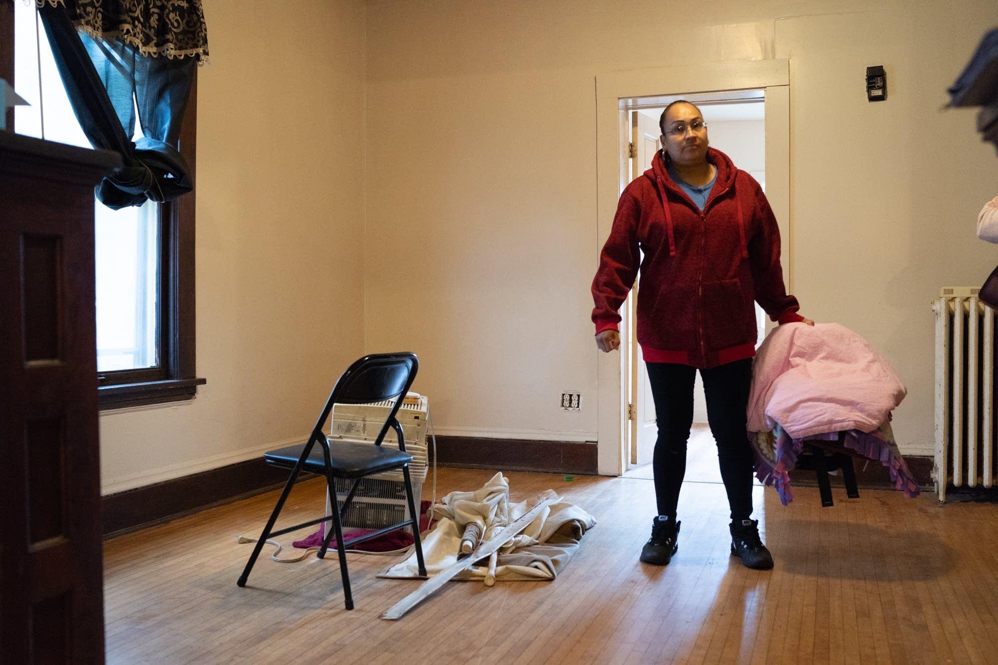 Melody Johnson checks out a north Minneapolis apartment.