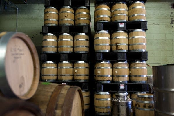 Rum and whiskey aging in barrels