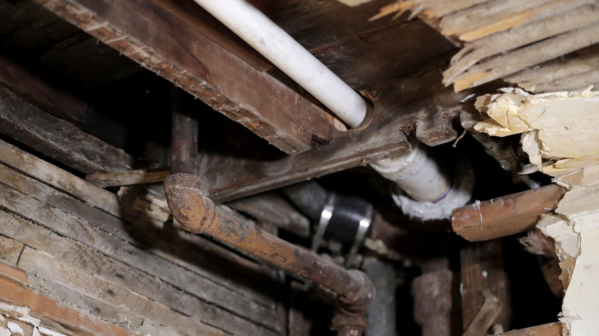 A lead pipe in the kitchen ceiling