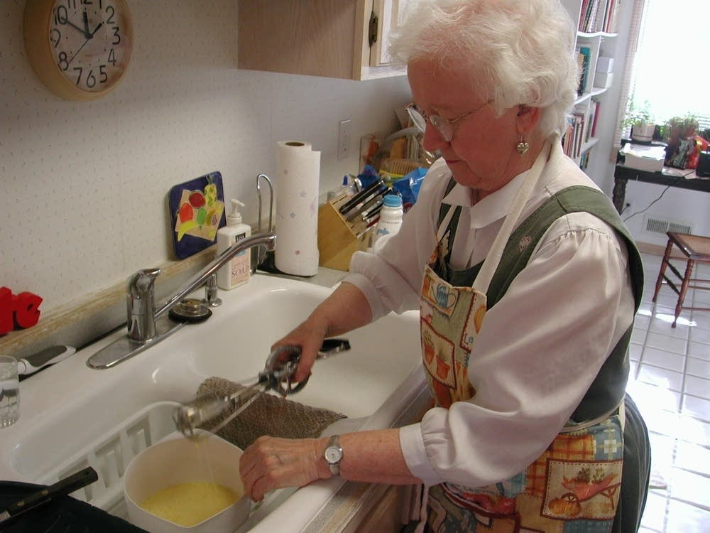 Ann Burckhardt beats eggs for her hotdish