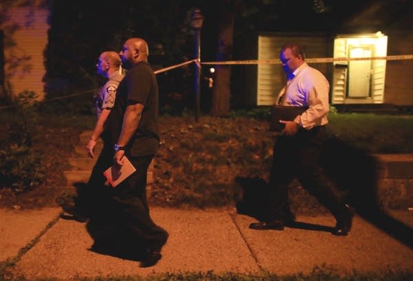 Police and investigators on the scene of a police shooting.