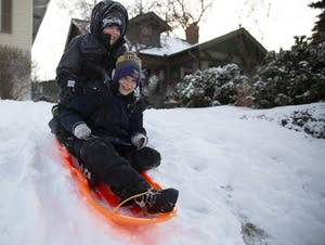 Reed and Brennan Schumann, 14 and 10, sled during their snow day.