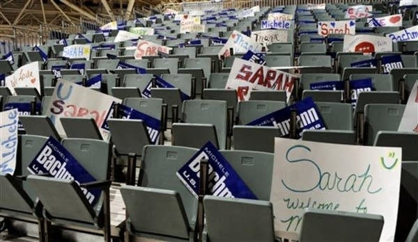 Signs at the Bachmann-Palin rally