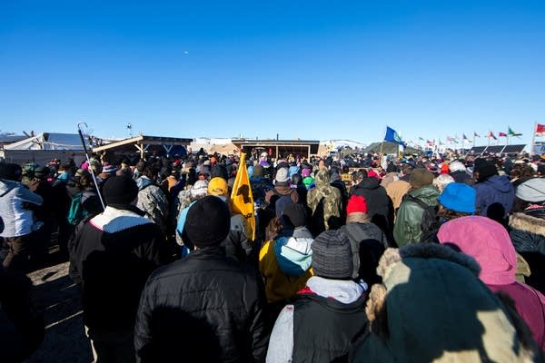 People gather around the area of the Sacred Fire