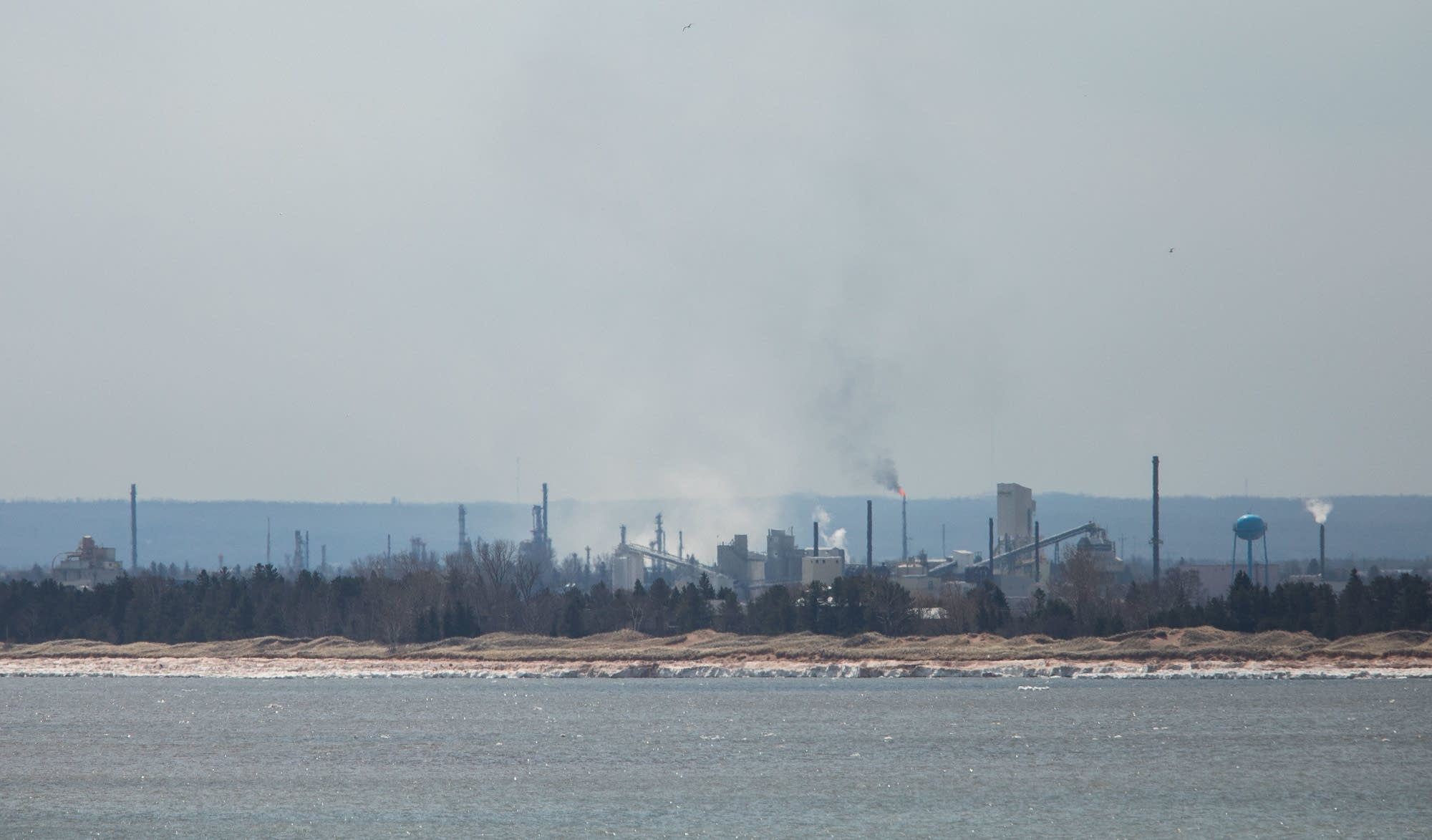 White smoke rises from the site of the Husky Energy refinery around noon.