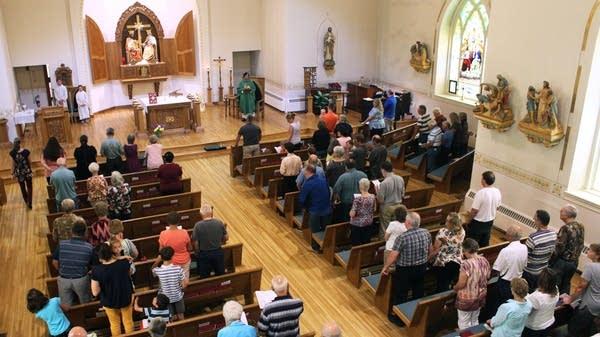 Parishioners gather in a church.