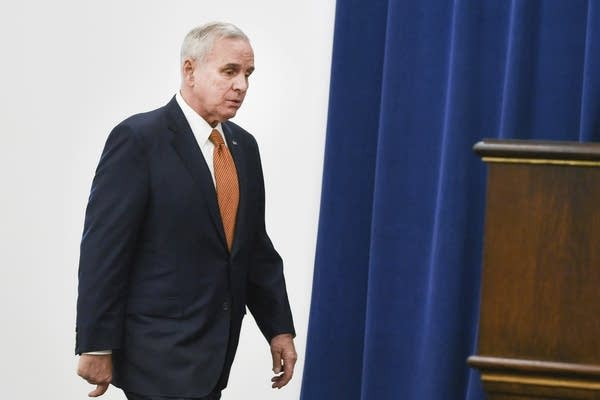 Governor Mark Dayton enters a press conference.