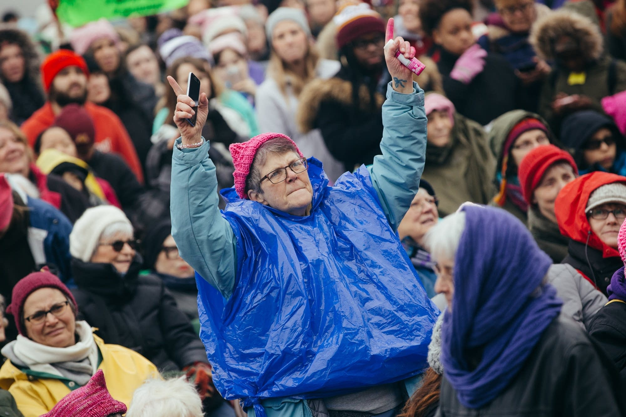 A demonstrator dances in the crowd.