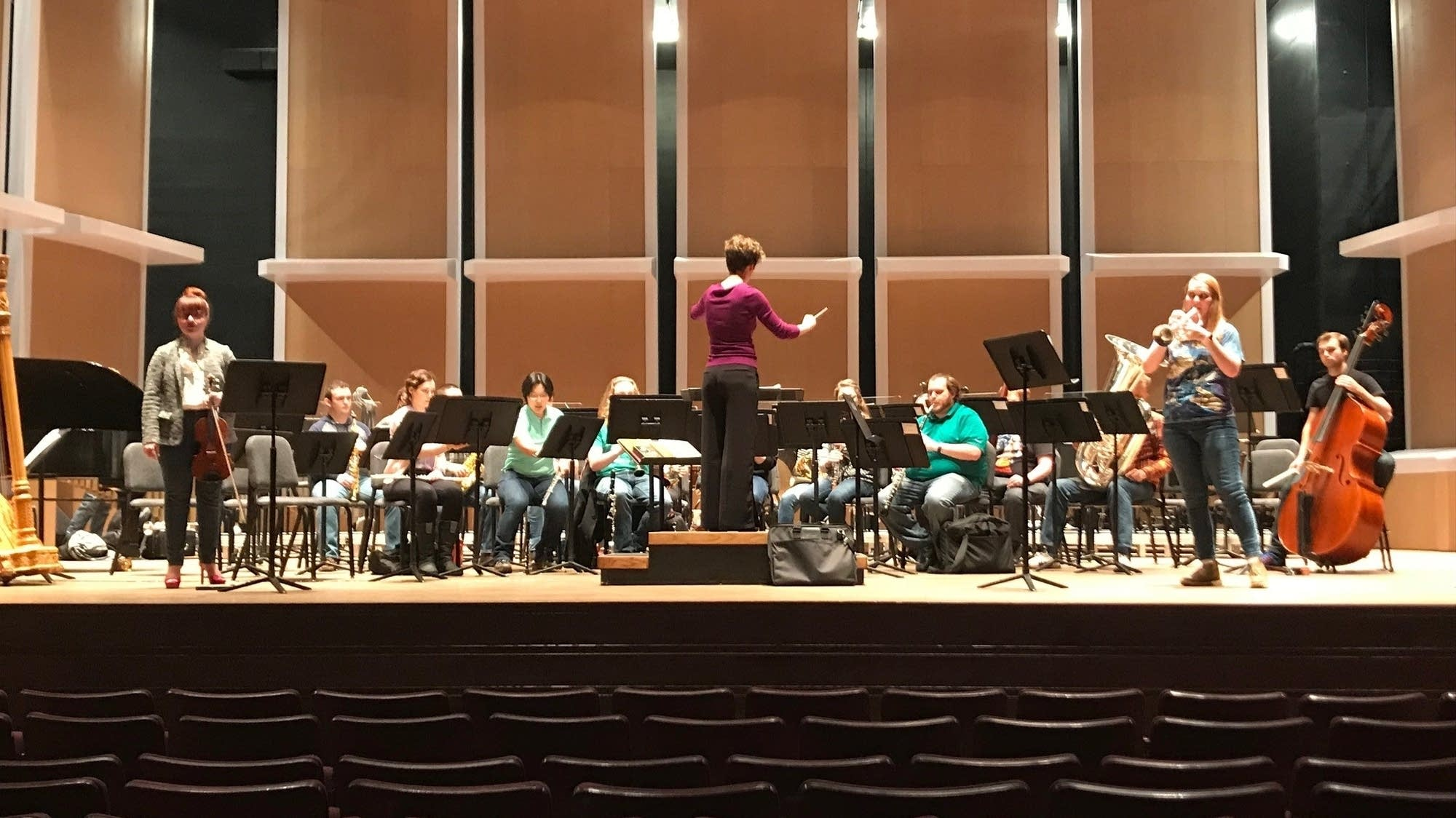 Judy Gaunt, right, rehearses with the U Wind Ensemble.