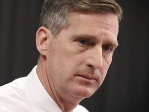 Minnesota athletic director Mark Coyle speaks during a news conference.