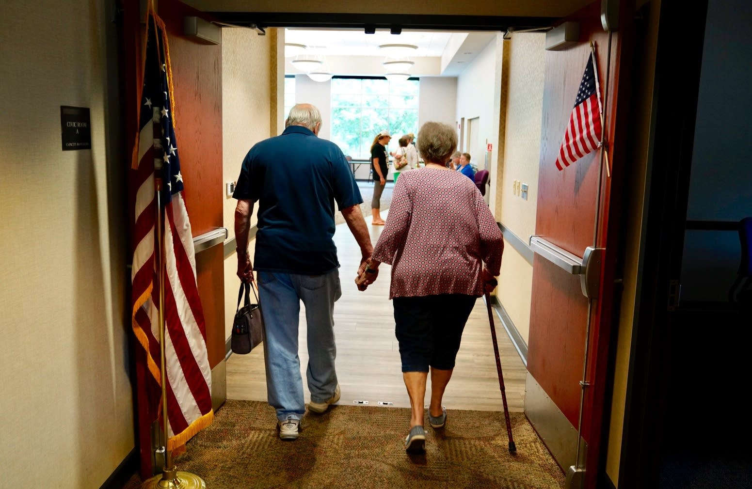 A couple arrives to vote in Coon Rapids.