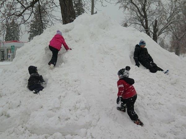 Children play on a snow bank in Brainerd.