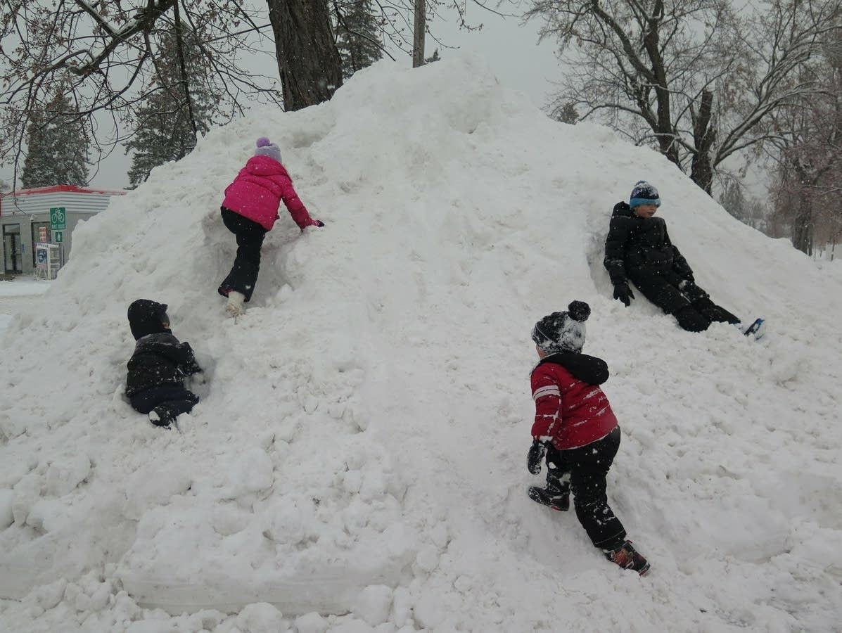 Children play on a snow bank in Brainerd.