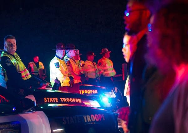 State Patrol troopers and protesters