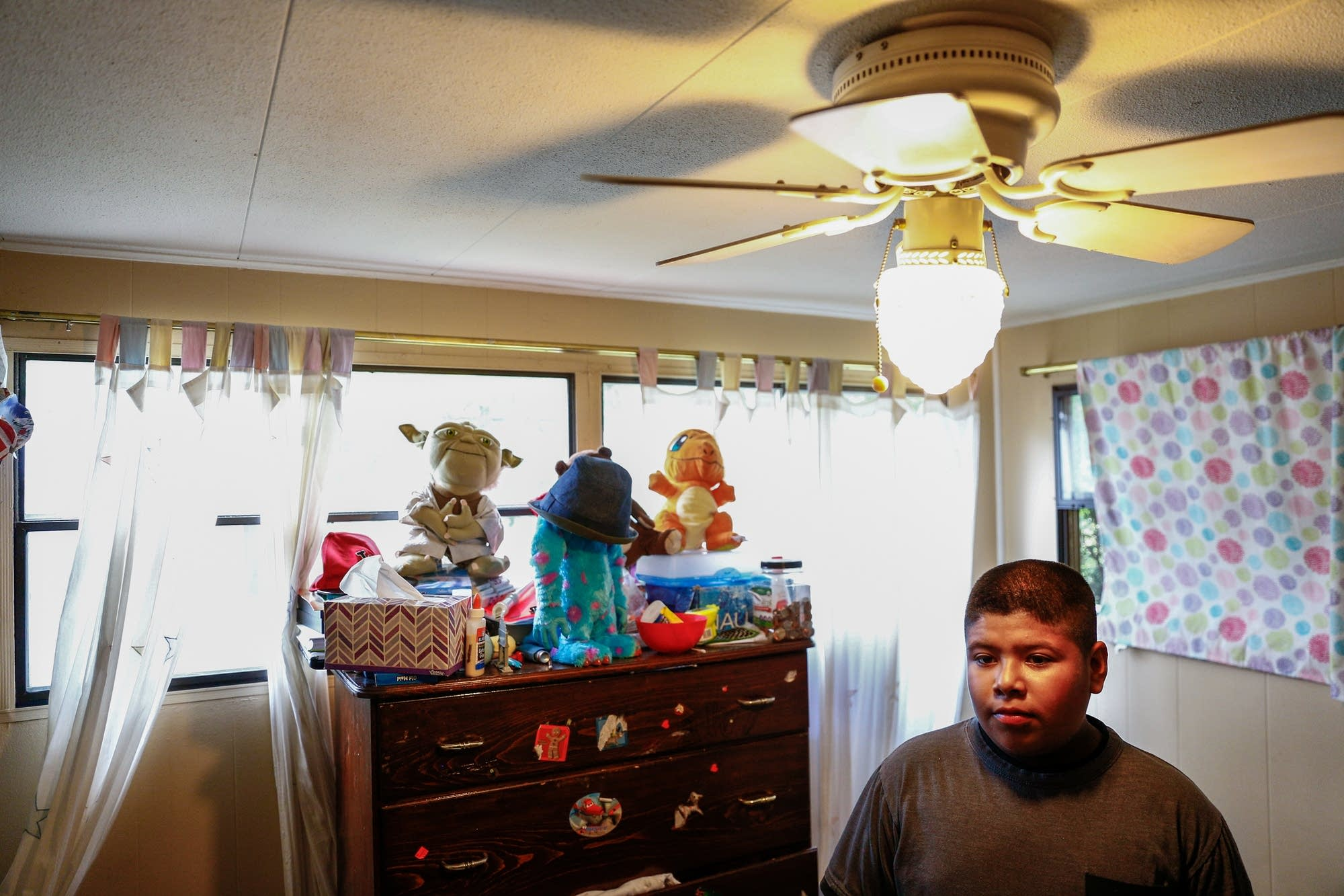 Elvy Rosendo stands in his room.