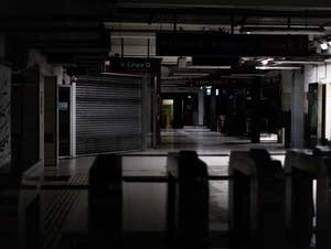 Hallways of Buenos Aires' subway are lit only by emergency lights