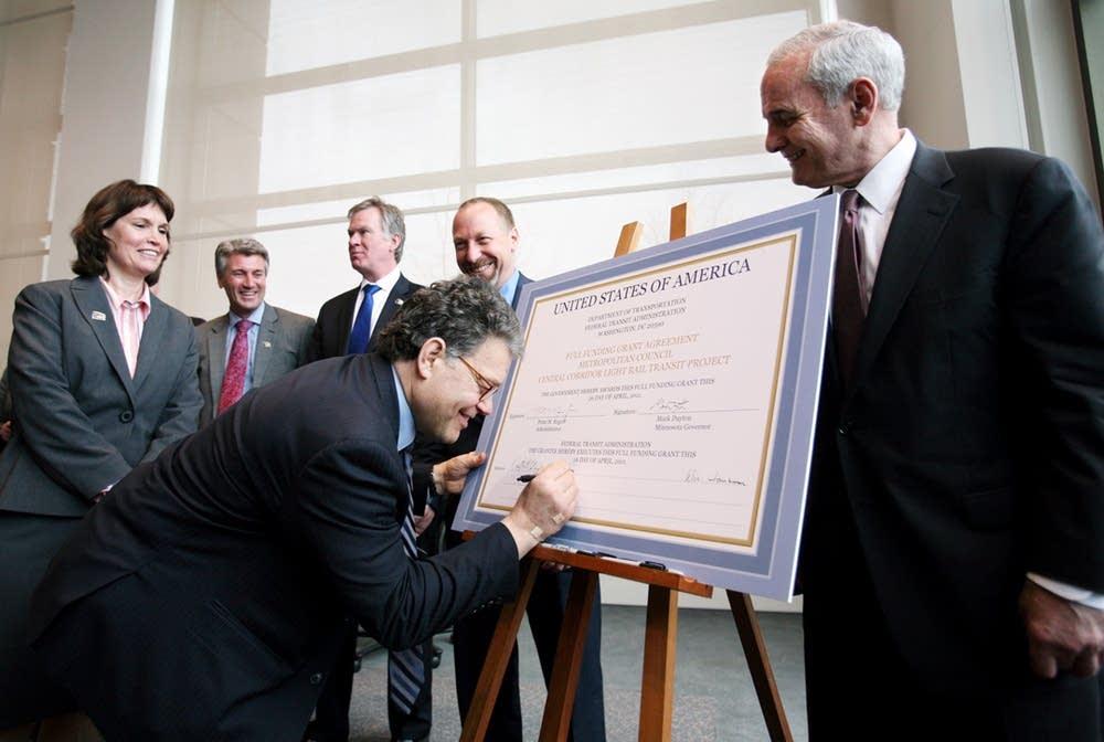 Franken signs funding agreement