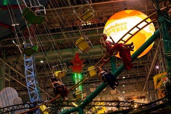 Students on an amusement park ride.