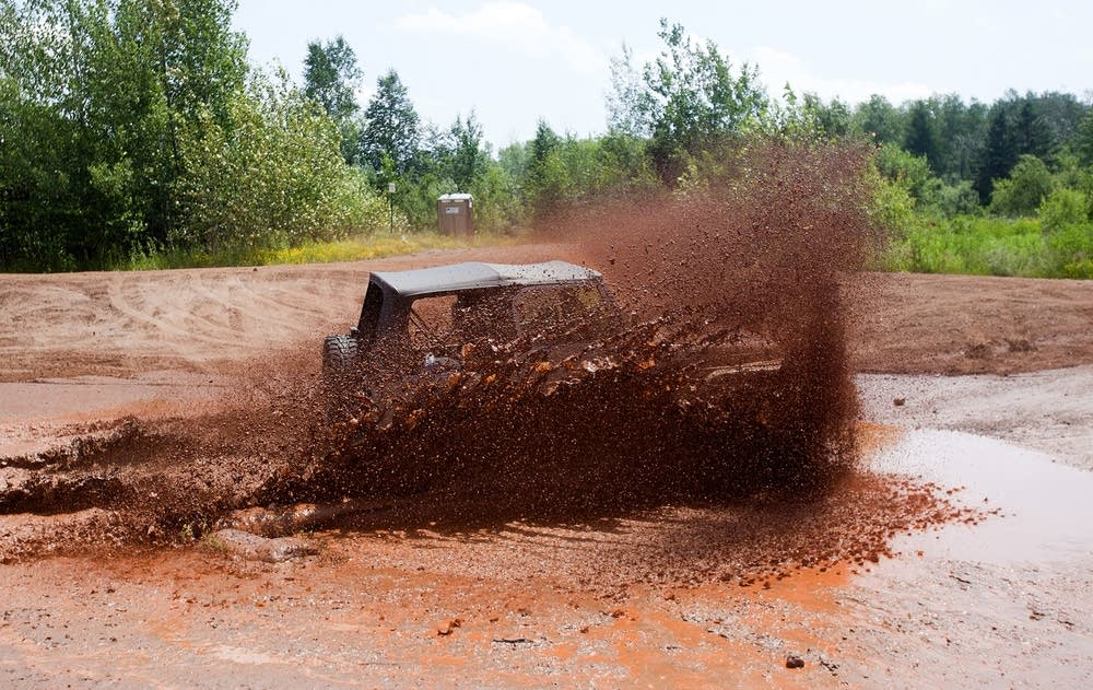 Driving through a mud pit