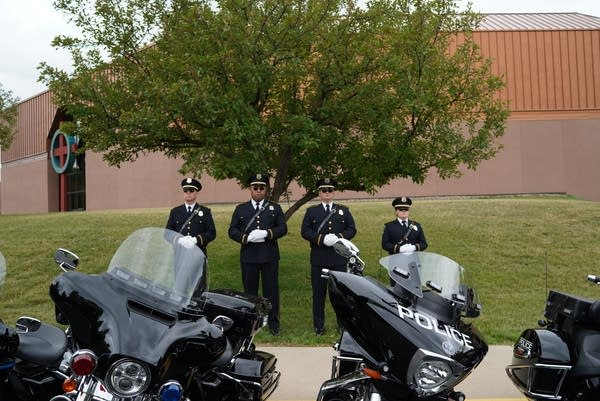 Police officers outside of North Heights Lutheran Church.