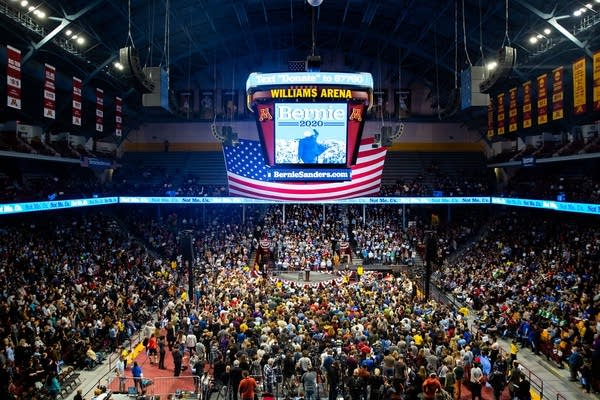 People fill an arena.