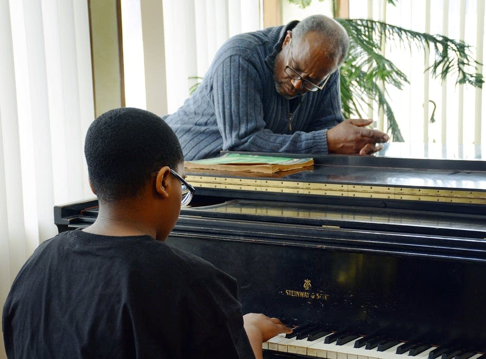 Grant West teaching a piano lesson