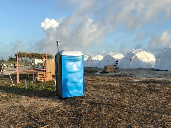 Tents and a portable toilet at Fyre Festival