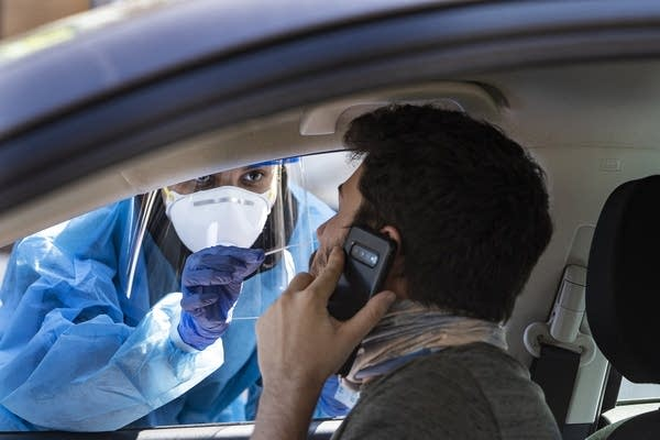 A person in a car gets tested.