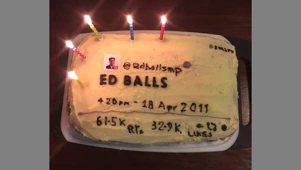 "A cake decorated to look like a tweet that says ""ED BALLS"""