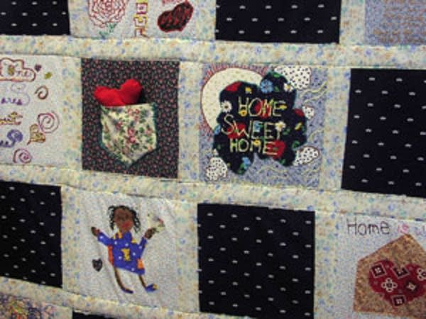A quilt hangs in the parenting room