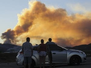 People watch the Blue Cut wildfire.