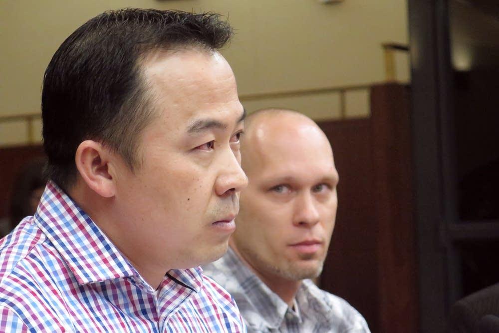 Koua Fong Lee, left, and Michael Hansen testify.