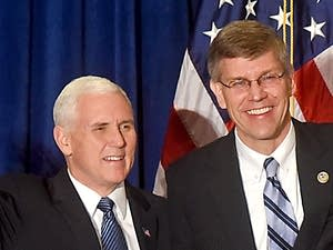 VP Mike Pence, left, greets supporters with Rep. Erik Paulsen.