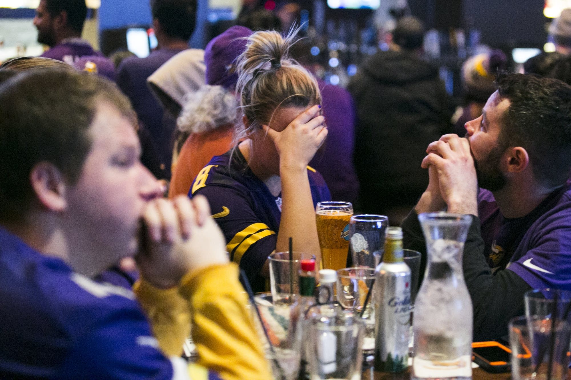 Fans react to a play in the third quarter.