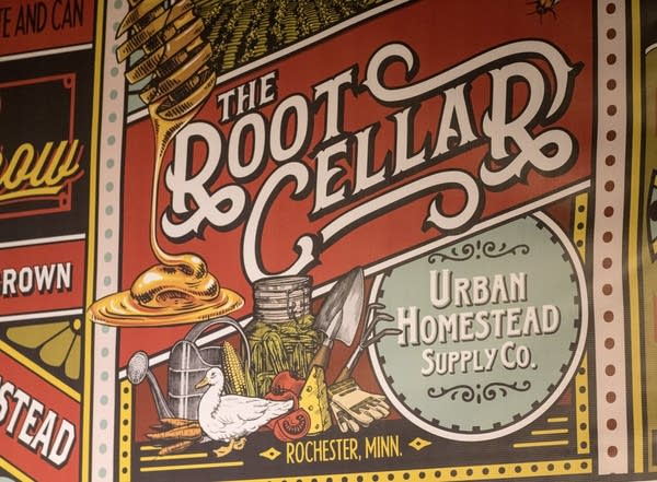 Signs for The Root Cellar inside Forager Brewing.