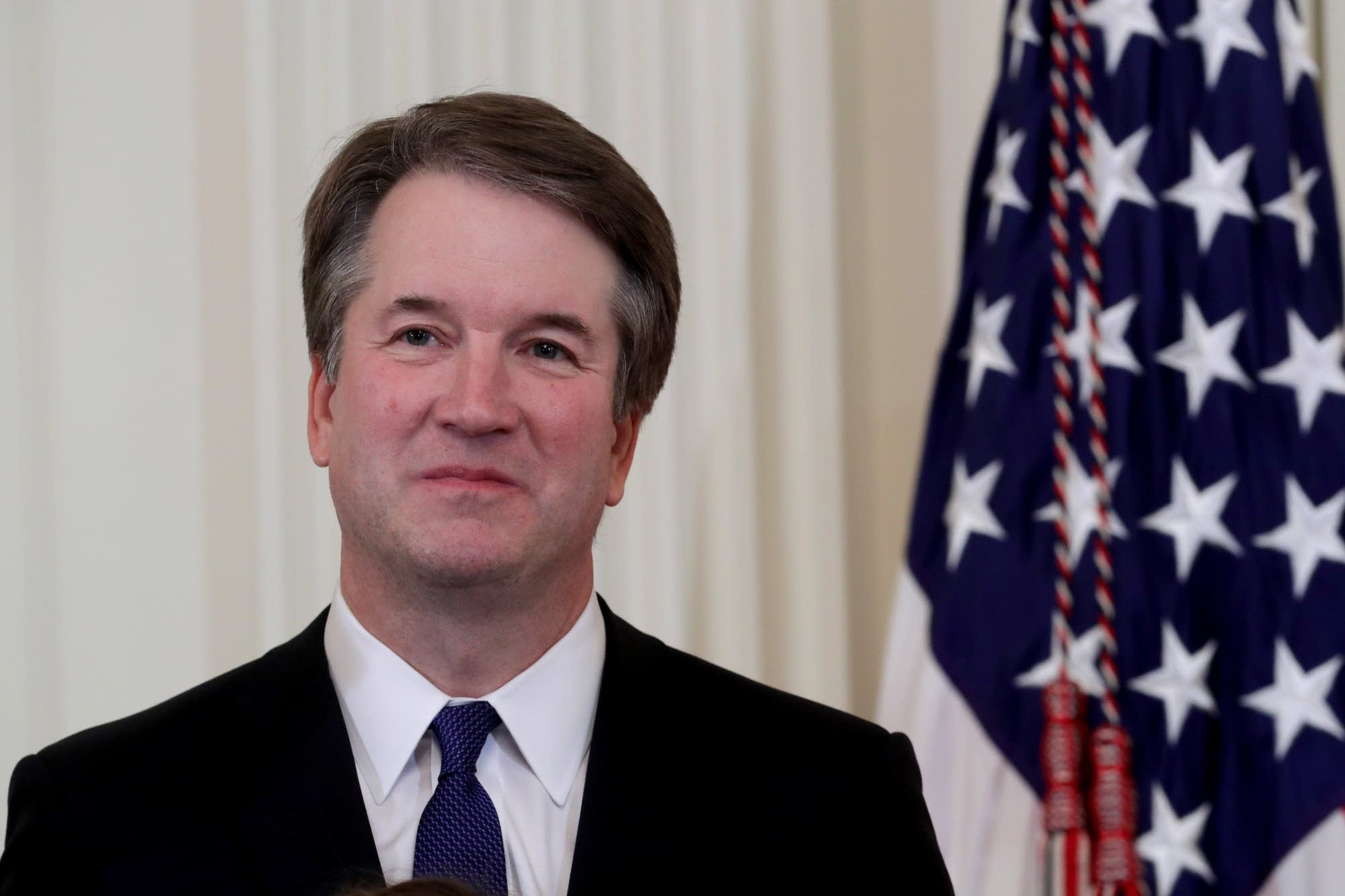U.S. Circuit Judge Brett M. Kavanaugh looks on.