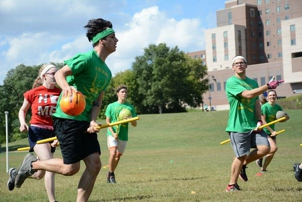 Two intramural quidditch teams face off.