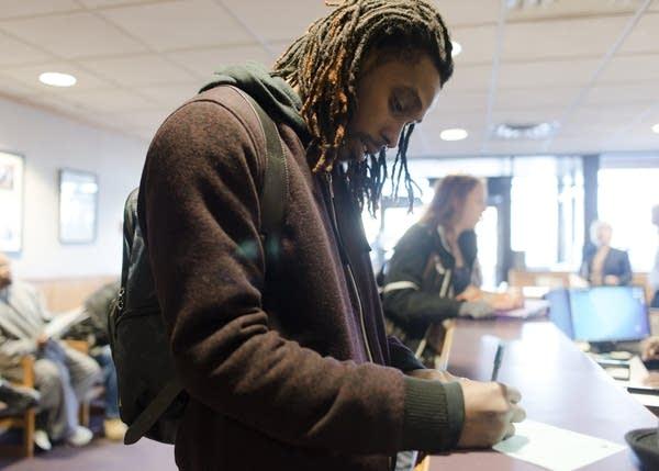 Douglas Patten fills out his school registration.