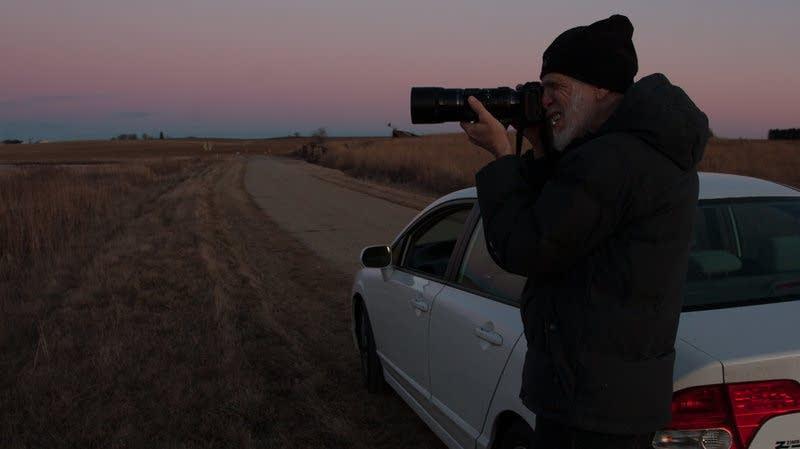 Neal Deunk photographs geese at a wildlife refuge.