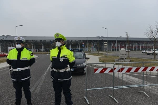 Police officers block the access to Schiavonia hospital.