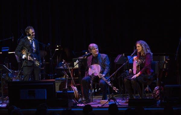 Chris, Bela, and Abigail talk banjos.