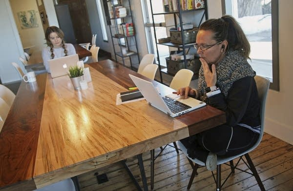 Kristin Nilsen, right, a writer, works in the Quiet Room at ModernWell.