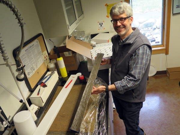 Mark Edlund holds a sediment core.