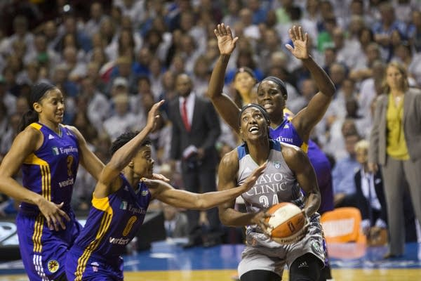 Sylvia Fowles takes the ball to the rim.