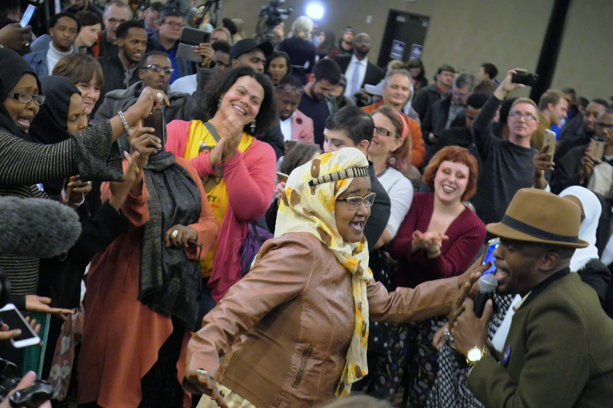 Supporters dance at Ilhan Omar's election night party.