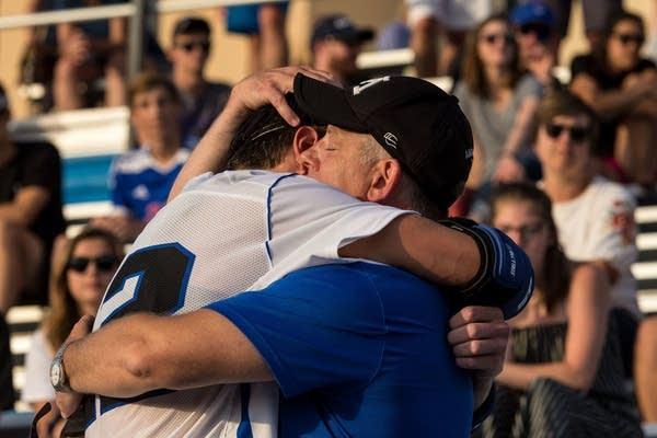 Donald Amorosi embraces Archer's friend Luke Tollefson.