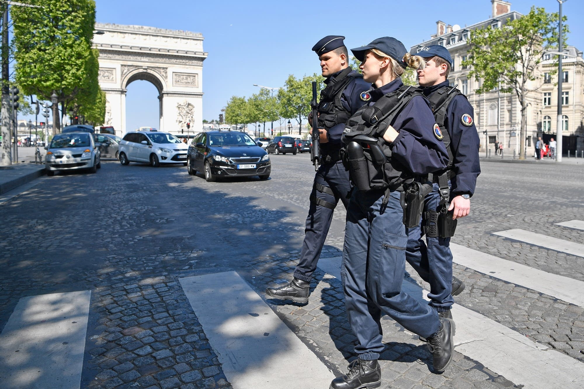 Armed police patrol the Champs-Elysees in Paris