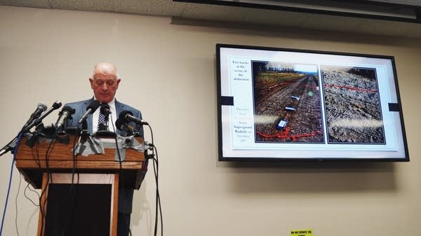 Stearns County Sheriff showing photos of tire tracks and footprints