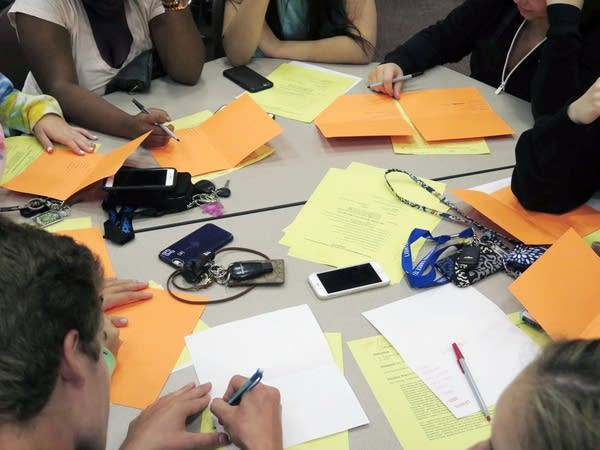 Students brainstorm ways to think positively.